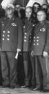 Капитан комических войск А.Куприянов между начальниками - генералом Е.Панченко и космонавтом-2 Г.Титовым